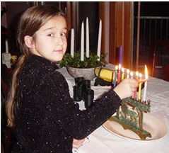 Sorena lights the menorah