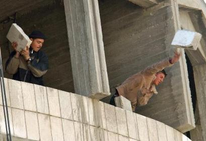 palestinians throwing chunks of cement